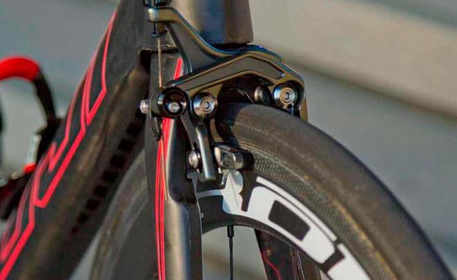 Что такое клещевой тормоз для велосипеда?